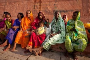 9891456-varanasi-india--july-22-2009-group-of-indian-women-in-colorful-saris-sit-and-watch-the-solar-eclipse